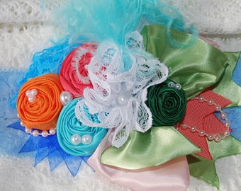 Orange, blue, and coral Rosette Headband by Caprice Colette