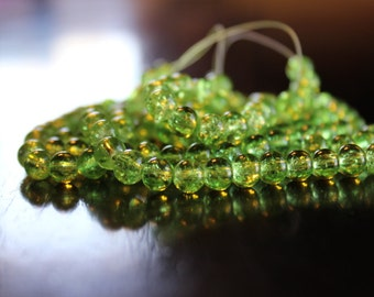 135 approx. light green, 6 mm crackle glass beads, 1mm hole, round and smooth
