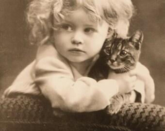 Young Girl hugging cat- Photo Print