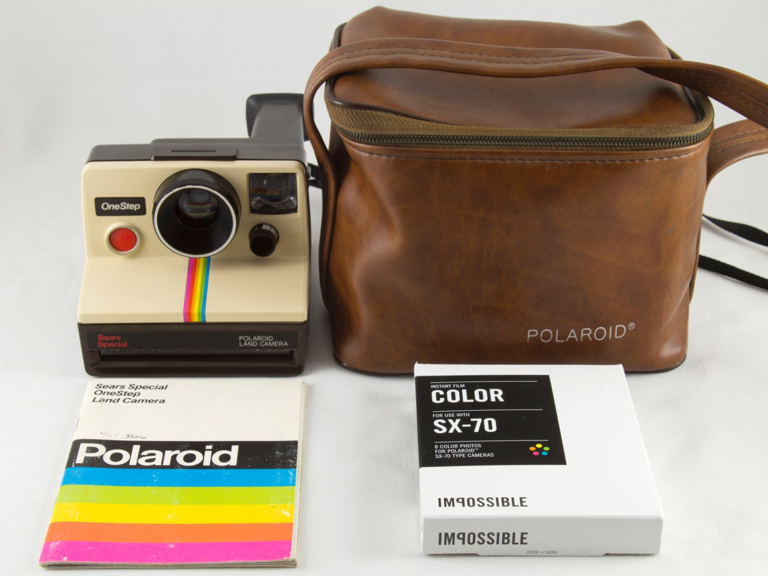 vintage polaroid 600 camera kit by impossible project Category: impossible project (polaroid) impossible color film for sx-70 rm200-rm500 tags polaroid camera, instant camera, vintage polaroid camera, polaroid 600.