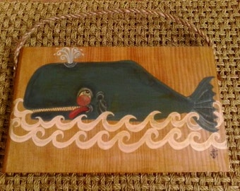 Blue whale and waves on recycled wood