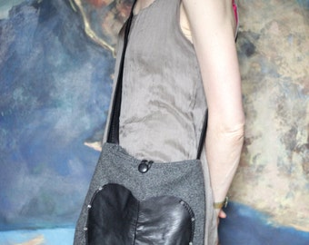Medium, across your shoulders, black leather and grey tweed bag with heart pocket