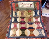 FREE Shipping U.S. Only.  A One of A Kind Hand Pieced and Hand Quilted Miniature with Cross Stitch Accents Tablerunner Wall Hanging
