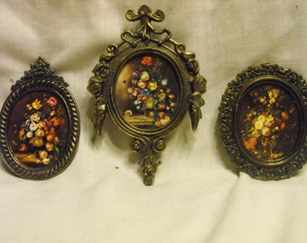 Vintage 3 piece Ornate Baroque Brass Oval Frames with Pictures of Floral arrangements. Made in Italy. All original and just flawless!