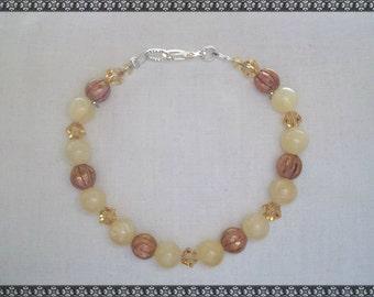 yellow bracelet, yellow beaded bracelet, pale yellow, brown, light brown