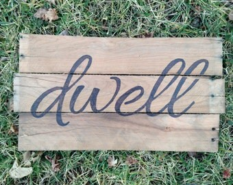 Dwell wood sign