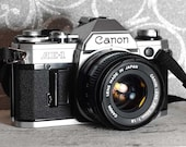 Canon AE-1 35mm SLR camera new battery- With 50mm f1.8 FD lens - vintage camera