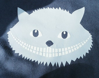Cheshire Cat! 'Glow in the dark' kids t-shirt with a print of the Cheshire Cat.