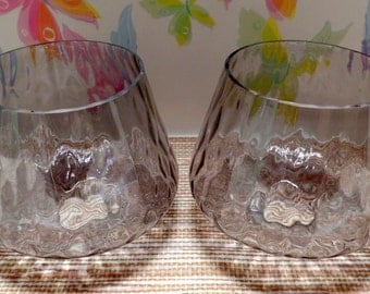 A set of 3 vintage glass light globes, shades.  They have a wavy surface, and are very shiny