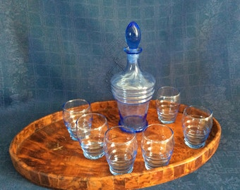 A smalll blue bottle and glass SET