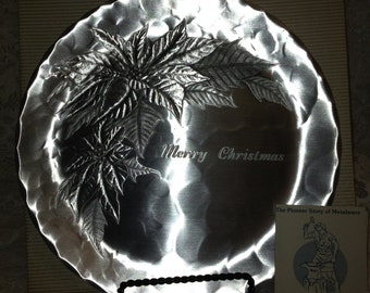 "Vintage Wendell August Forge Poinsettia Plate Enscribed with ""Merry Christmas"", scratched and smudged, but still pretty."