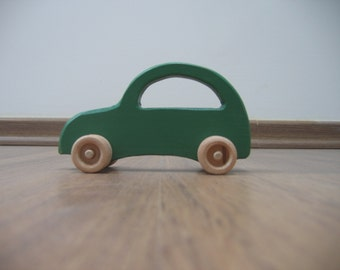 Green toy car made of wood