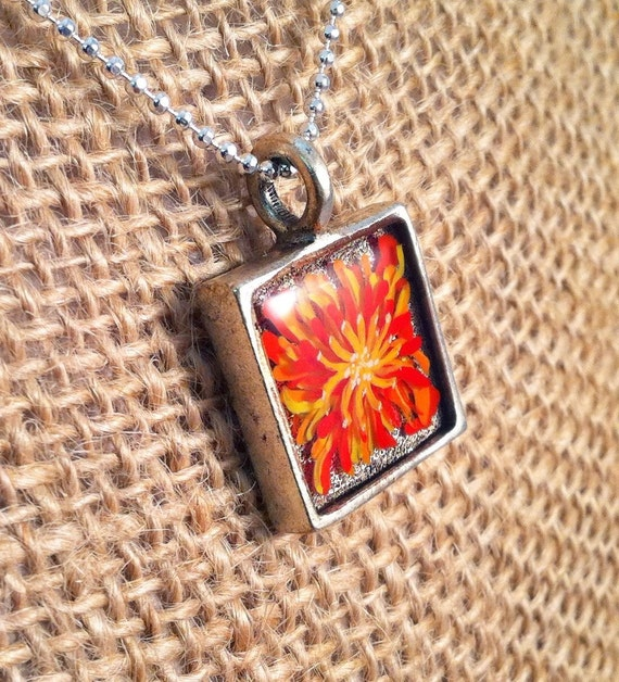 Hand painted mum (flower) pendant -  resin in a square silver bezel