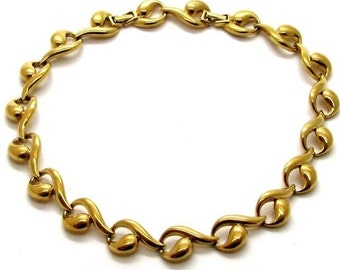 NINA RICCI, gold-tone metal necklace,shaped with vintage arabesques