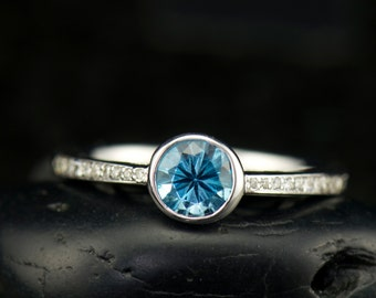 Kylee - Blue Topaz and Diamond Engagement Ring in White Gold, Bezel Set Round Brilliant Center with Channel Set Accents, Free Shipping