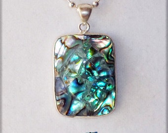 """Authentic movie artifact abalone pendant necklace covered by """"It's a Mad, Mad, Mad, Mad World"""" car glass"""
