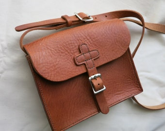 Small leather shoulder bag, hand-stitched, with cross motif