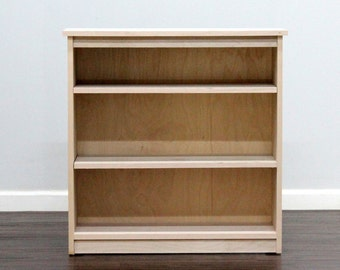 Birch Bookcase with two adjustable shelves, wide.