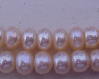 "Freshwater Pearls; 6mm button, pale peach color, 16"" strand"