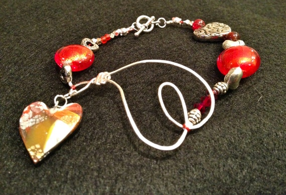Handmade bracelet with contemporary multicolor polymer clay heart charm, silver wire heart, red glass and silver/silver plated heart beads