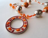 Orange beaded necklace - matching earrings