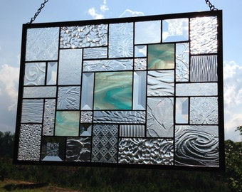 Sky Blue Opalescent Wispy stained glass panel with multiple-textured clear glasses & bevels to accentuate this lovely panel.
