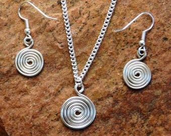 Jewelry set spirals of silver wire necklace with pendant and earrings