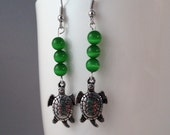 Green glowing cats eye beads with turtle charm earrings (ITMNUM 21)