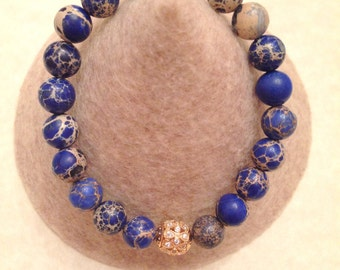 Genuine Crazy Lace Agate stretch bracelet with gold plated details