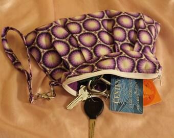 Purple pleated wristlet