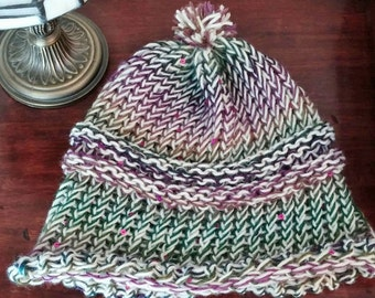 Soft and warm hand-knitted hat.