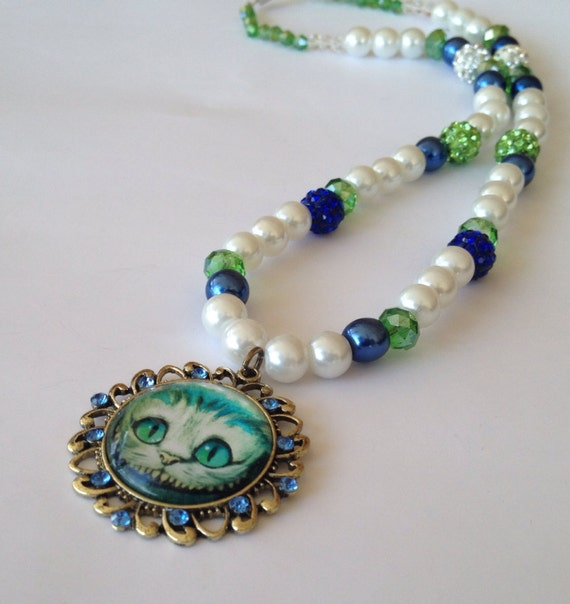 cheshire cat pendant with blue and white beaded by
