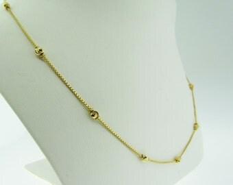 "Vintage 16"" long 21 K gold ball necklace."