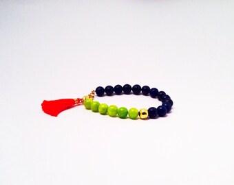 Beaded tassel bracelet // Stacking boho bracelet // Navy blue jasper, lime green quartz, and gold bead bracelet