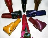 Hand Made leather holster/ case for protecting, carrying and storing of glass pipe. Assorted colors, sizes and styles