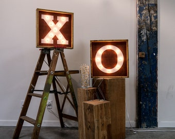 XO Handcrafted wooden light bulb sign.