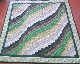 Handcrafted green patchwork bargello lap quilt.