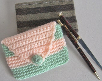 Business Card Case-handmade in a crochet stitch with a light green and apricot acrylic yarn. This petite accessory will protect your cards.