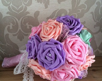 Pastel rose bouquet with pearl and diamanté pins, lace and satin ribbon