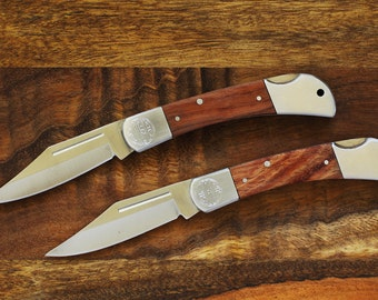 set of 2 engraved pocket knives
