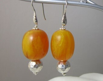 Smooth African Amber beads wire wrapped with Hammered 925 Sterling Silver rounds together suspended from hammered 925 Silver earwires