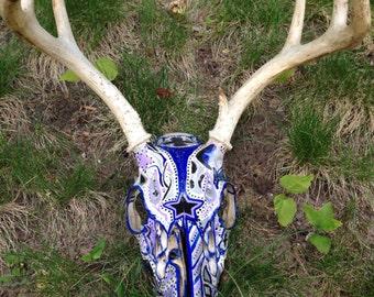 Painted deer skull