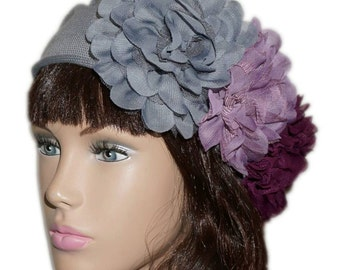 Gray beret adorned with 3 big veil and tulle flowers, mauve, purple and gray.