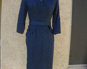 Fits like a glove. 1950's beautiful navy blue dress.