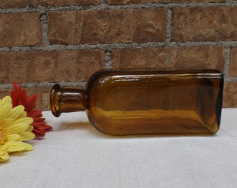 Large amber bottle