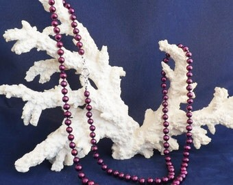 """42"""" Hand Knotted hot purple fresh water pearl necklace."""