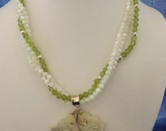 "18"" - 3 strand Bleached mother of pearl and peridot necklace and earrings."