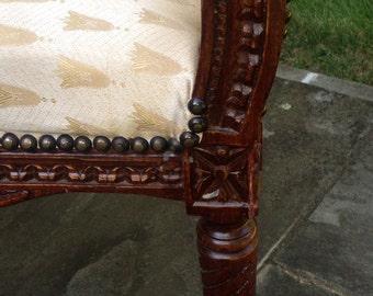 Creme damask upholstered bench with carved wood frame