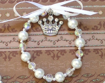 Pearl and crystal bracelet for little girls Rhinestone crown or tiara charm with bow Shiny Bling Perfect Princess Gift