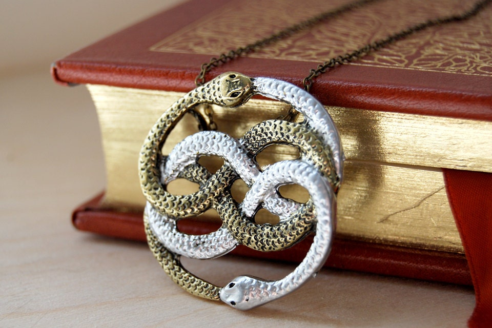 a token from an infinite story auryn necklace 80 s